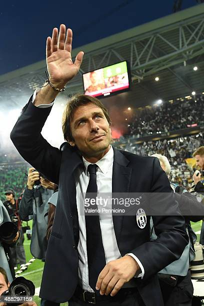 Juventus head coach Antonio Conte salutes during the Serie A match between Juventus and Atalanta BC at Juventus Arena on May 5 2014 in Turin Italy