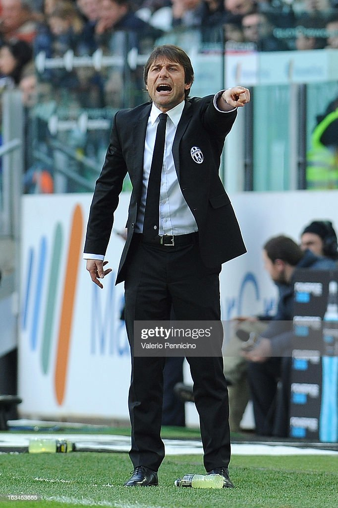 FC Juventus head coach Antonio Conte shouts to his players during the Serie A match between FC Juventus and Calcio Catania at Juventus Arena on March 10, 2013 in Turin, Italy.