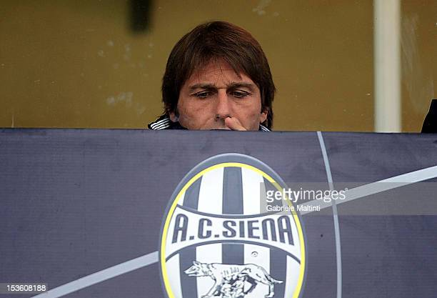 Juventus head coach Antonio Conte watches the Serie A match between AC Siena and FC Juventus at Stadio Artemio Franchi on October 7 2012 in Siena...