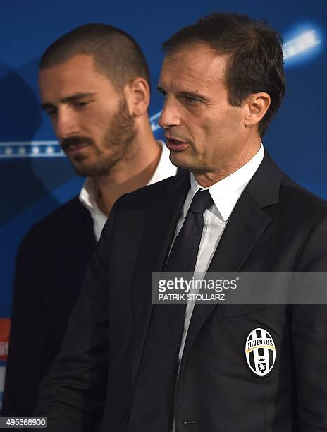 Juventus' head coach Massimiliano Allegri and his defender Leonardo Bonucci addresses a press conference on the eve of the Group D secondleg UEFA...