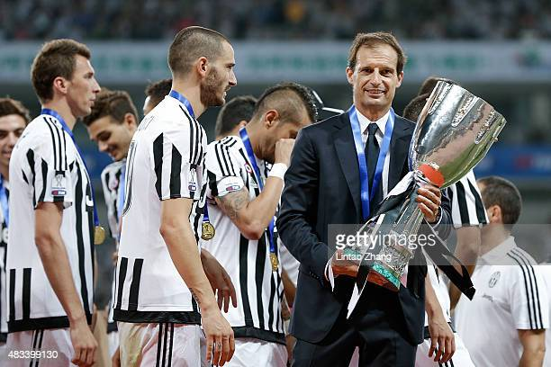 Juventus head coach Massimiliano Allegri celebrates with the trophy after team winning the Italian Super Cup final football match between Juventus...