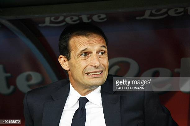 Juventus' Italian coach Massimiliano Allegri reacts as he attends the Italian Serie A football match SSC Napoli vs FC Juventus on September 26 2015...