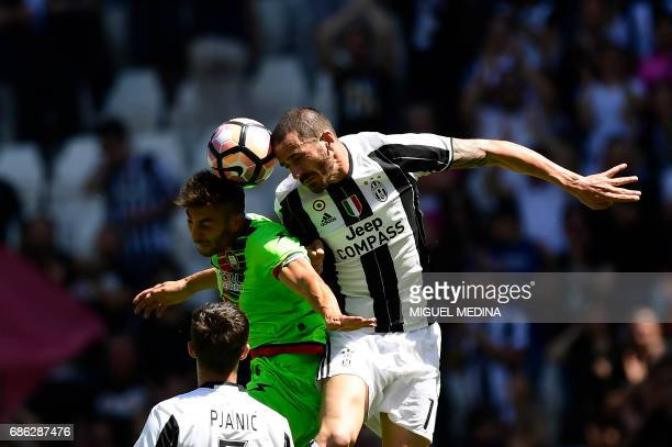 Juventus' Italian defender Leonardo Bonucci vies with Crotone's Italian defender Federico Ceccherini during the Italian Serie A football match...