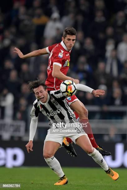 Juventu's Italian forward Federico Bernardeschi vies with Spal's Italian midfielder Federico Mattiello during the Italian Serie A football match...