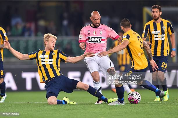 Juventus' Italian forward Simone Zaza vies for the ball with Hellas Verona's Swedish defender Filip Helander and Hellas Verona's Italian defender...