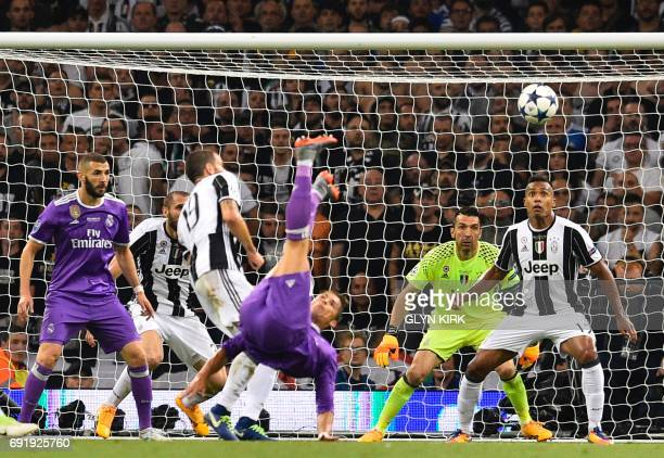 Juventus' Italian goalkeeper Gianluigi Buffon and Juventus' Brazilian defender Alex Sandro watch as Real Madrid's Portuguese striker Cristiano...