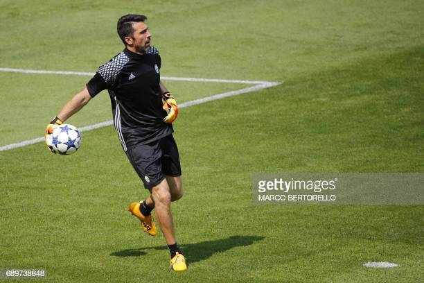 Juventus' Italian goalkeeper Gianluigi Buffon attends the training session during the Media Day prior to the UEFA Champions League football match...