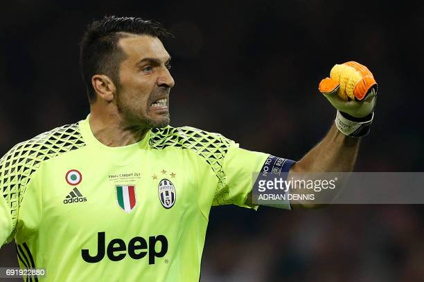 Juventus' Italian goalkeeper Gianluigi Buffon celebrates after Juventus equalised during the UEFA Champions League final football match between...