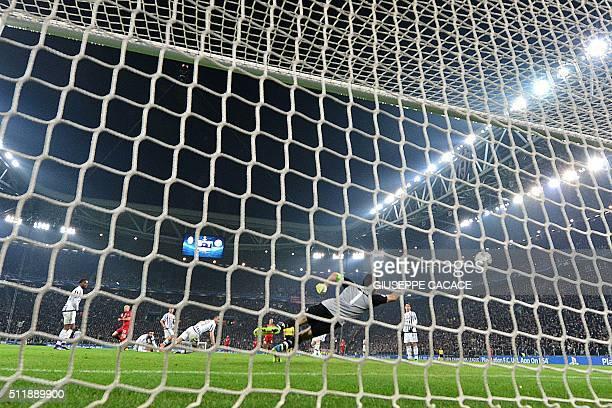 Juventus' Italian goalkeeper Gianluigi Buffon concedes a goal to Bayern Munich's Dutch midfielder Arjen Robben during the UEFA Champions League round...