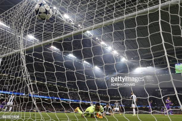 TOPSHOT Juventus' Italian goalkeeper Gianluigi Buffon fails to stop a goal from Real Madrid's Portuguese striker Cristiano Ronaldo during the UEFA...