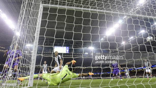 Juventus' Italian goalkeeper Gianluigi Buffon fails to stop a goal from Real Madrid's Portuguese striker Cristiano Ronaldo during the UEFA Champions...