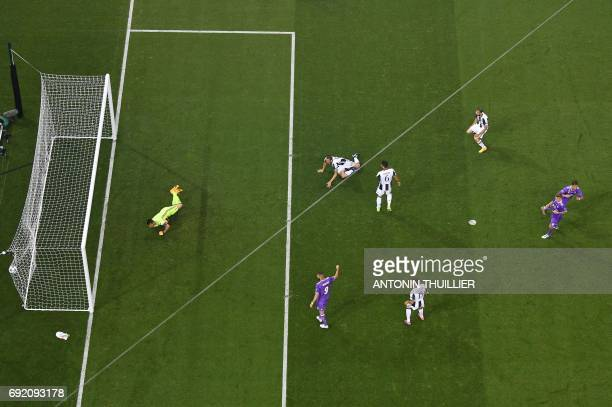 Juventus' Italian goalkeeper Gianluigi Buffon fails to stop the first goal from Real Madrid's Portuguese striker Cristiano Ronaldo during the UEFA...