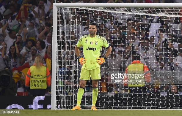 Juventus' Italian goalkeeper Gianluigi Buffon reacts after Real Madrid scored their second goal during the UEFA Champions League final football match...