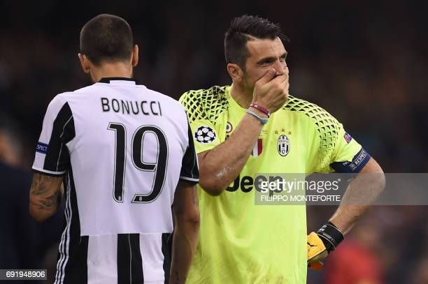 Juventus' Italian goalkeeper Gianluigi Buffon reacts after Real Madrid won the UEFA Champions League final football match between Juventus and Real...