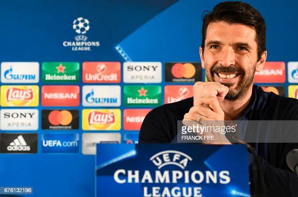 Juventus' Italian goalkeeper Gianluigi Buffon smiles during a press conference at the 'Louis II Stadium' in Monaco on May 2 2017 on the eve of their...