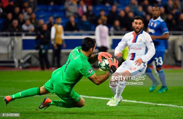 Juventus' Italian goalkeeper Gianluigi Buffon stops the ball in front of Lyon's French midfielder Jordan Ferri during the Champions League football...