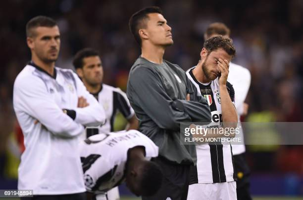 Juventus' Italian midfielder Claudio Marchisio reacts after losing the UEFA Champions League final football match between Juventus and Real Madrid at...