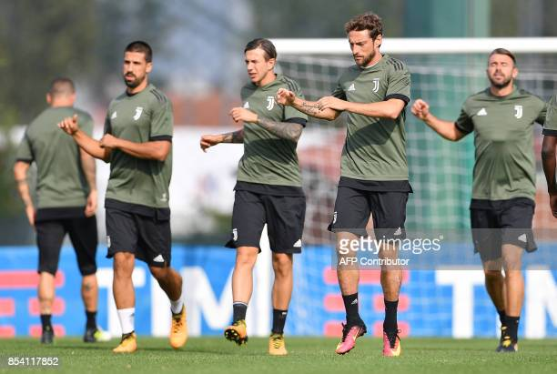 Juventus' Italian midfielder Claudio Marchisio takes part in a training session on the eve of the UEFA Champions League football match between...