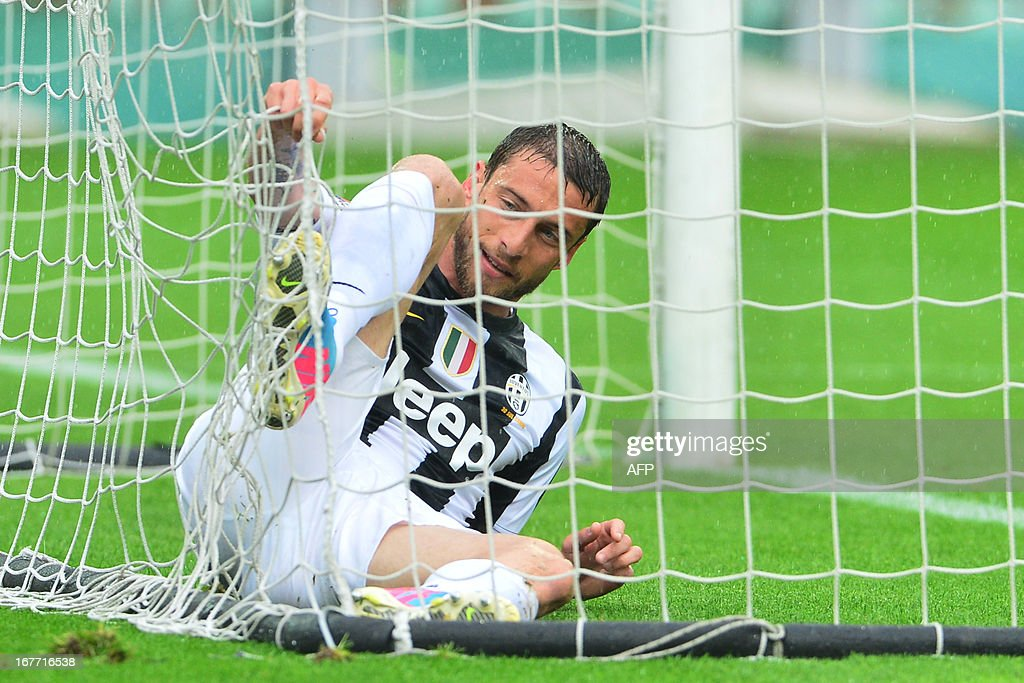 Juventus' Italian midfielder Claudio Marchisio untangles his foot from the goal's net during the Italian Serie A football match between Torino and Juventus on April 28, 2013 at the Olympic Stadium in Turin.