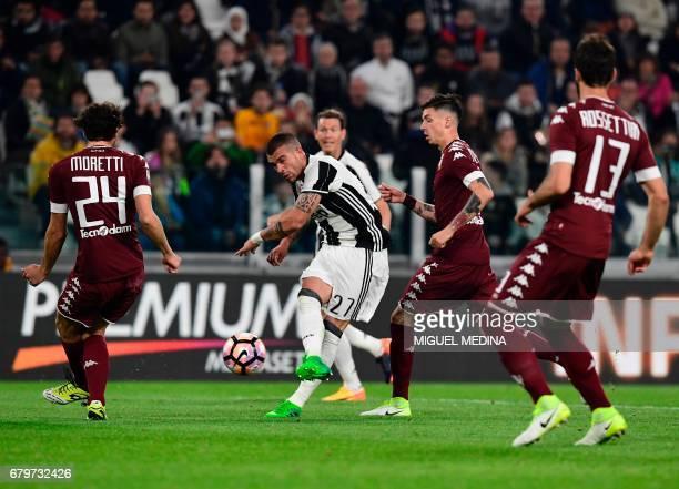Juventus' Italian midfielder Stefano Sturaro kicks the ball during the Italian Serie A football match Juventus vs Torino FC at the Juventus stadium...