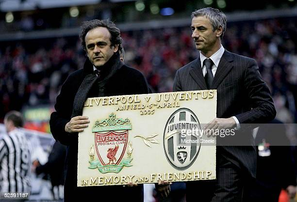 Juventus legend Michel Platini and Liverpool legend Ian Rush stand on the picth with a plaque commemorating the 20th anniversary of the Heysel...