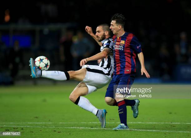 Juventus' Leonardo Bonucci battles for the ball with Barcelona's Lionel Messi