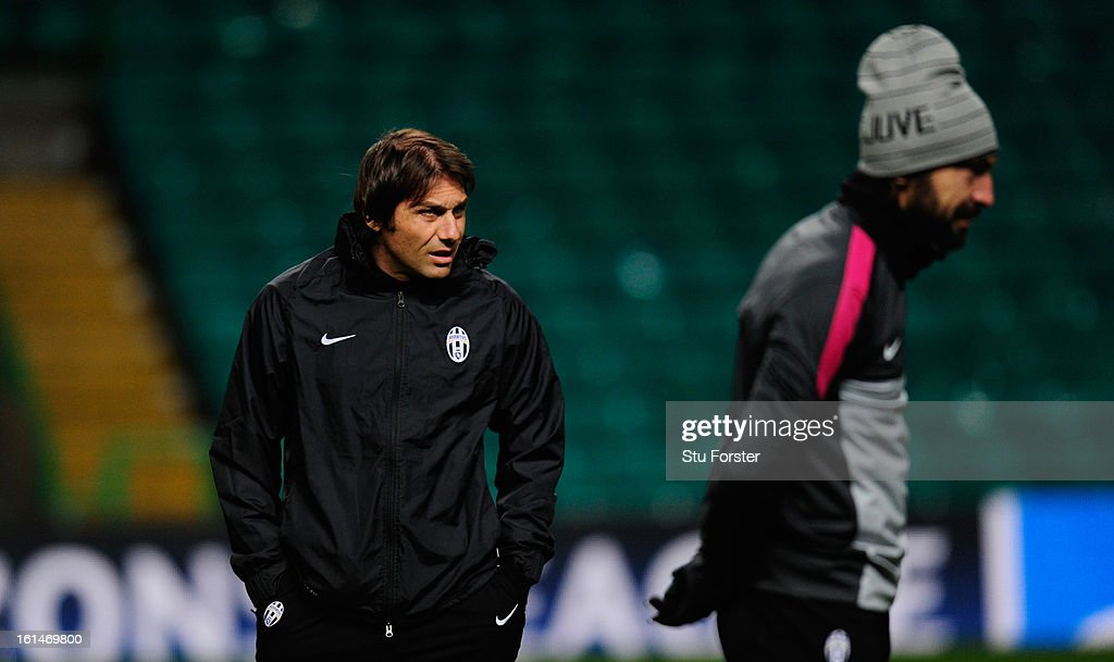 Juventus manager <a gi-track='captionPersonalityLinkClicked' href=/galleries/search?phrase=Antonio+Conte&family=editorial&specificpeople=2379002 ng-click='$event.stopPropagation()'>Antonio Conte</a> (l) and Andrea Pirlo look on during the Juventus training session at Celtic Park on February 11, 2013 in Glasgow, Scotland.