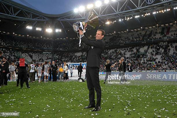 Juventus manager Massimiliano Allegri celebrates with the Scudetto Trophy after winning Serie A