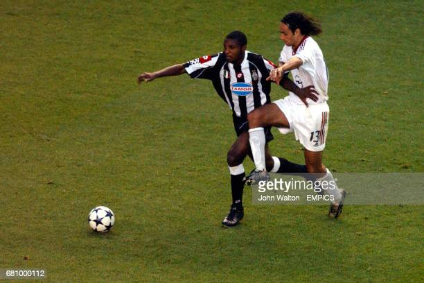 Juventus' Marcelo Danubio Zalayeta shields the ball from AC Milan's Alessandro Nesta