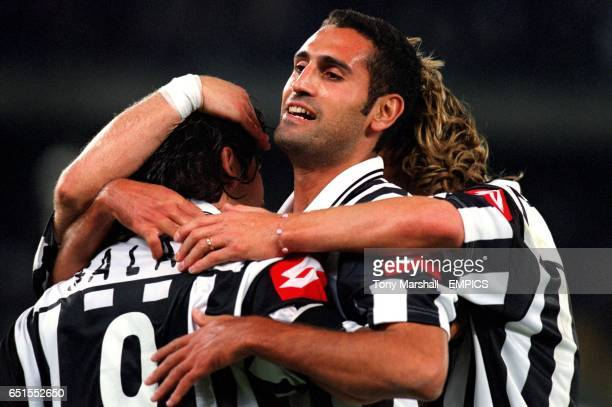 Juventus' Marcelo Salas is congratulated on scoring the winning goal by teammates Nicola Amoruso and Pavel Nedved