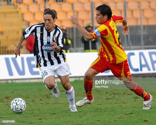 Juventus' Mauro Camoranesi challenges Leece's Cristian Ledesma during the Serie A match between Lecce and Juventus on October 23 2005 at the Via del...