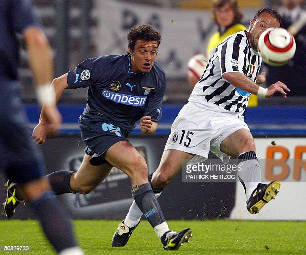 Juventus midfielder Alessandro Birindelli vies with Lazio's defender Massimo Oddo during their second leg of the Italian Cup final football match at...