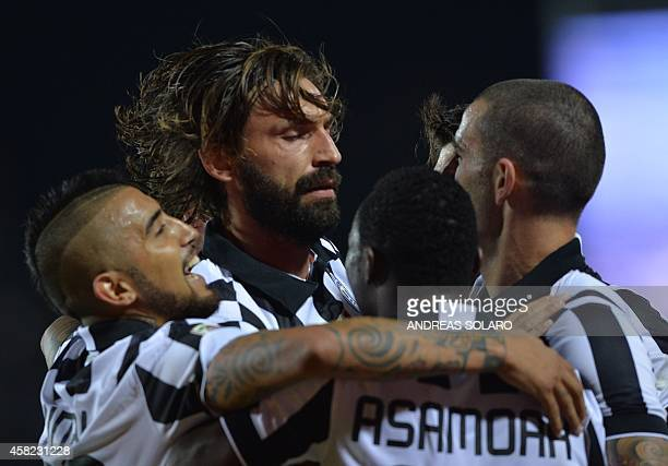 Juventus' midfielder Andrea Pirlo celebrateas with teammates after scoring during the Italian Serie A football match Empoli vs Juventus on November...