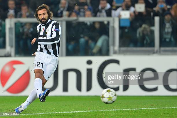 Juventus' midfielder Andrea Pirlo shoots a free kick during the Champions League football match between Juventus and Chelsea on November 20 2012 in...