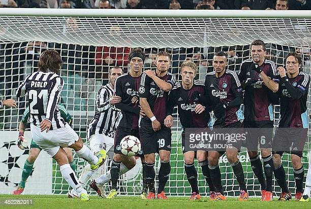 Juventus' midfielder Andrea Pirlo shoots a free kick in front of FC Copenhagen's defenders during the UEFA Champions League Group B football match...