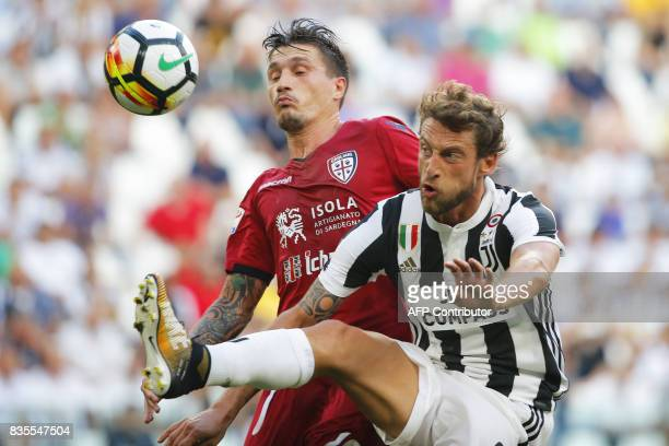 Juventus' midfielder Claudio Marchisio fights for the ball with Cagliari's midfielder Nicolo Barella during the Italian Serie A football match...