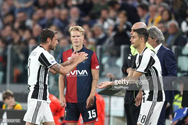 Juventus midfielder Claudio Marchisio shoots the ball Juventus midfielder Rolando Mandragora during the Serie A football match n33 JUVENTUS GENOA on...