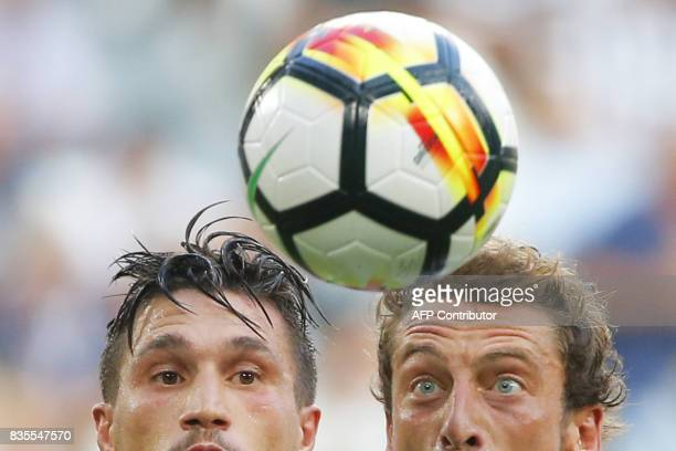 Juventus' midfielder Claudio Marchisio vies for the ball with Cagliari's midfielder Nicolo Barella during the Italian Serie A football match Juventus...