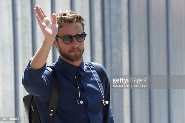 Juventus' midfielder Claudio Marchisio waves to fans as players arrive at the Turin Airport on June 4 a day after the UEFA Champions League final...