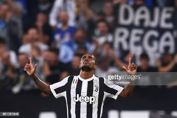 Juventus' midfielder Douglas Costa from Brazil celebrates after scoring during the Italian Serie A football match Juventus Vs Lazio on October 14...
