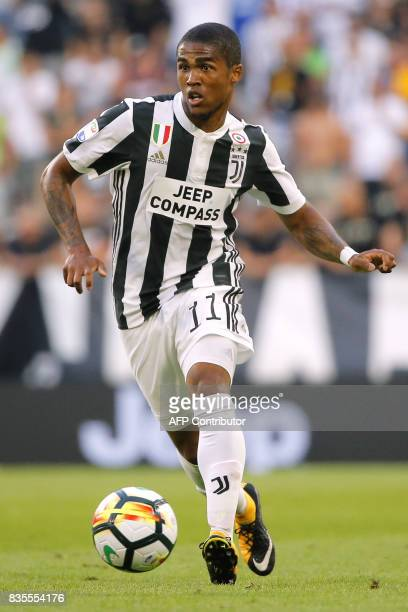Juventus' midfielder Douglas Costa from Brazil controls the ball during the Italian Serie A football match Juventus Vs Cagliari on August 19 2017 at...