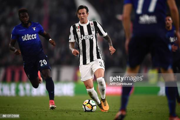 Juventus' midfielder Federico Bernardeschi controls for the ball during the Italian Serie A football match Juventus Vs Lazio on October 14 2017 at...