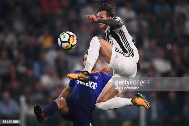 Juventus' midfielder Federico Bernardeschi fights for the ball with Lazio's forward Ciro Immobile during the Italian Serie A football match Juventus...