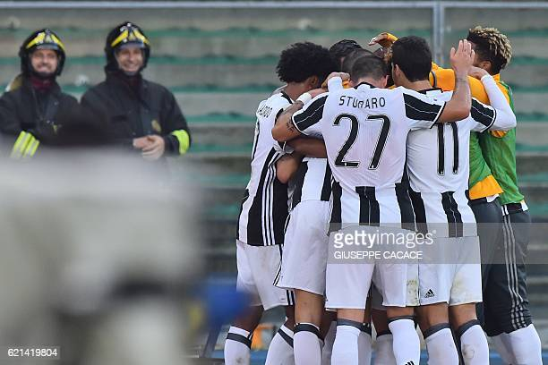 Juventus' midfielder from Bosnia Miralem Pjanic celebrates with teammates after scoring during the Italian Serie A football match Chievo Verona vs...