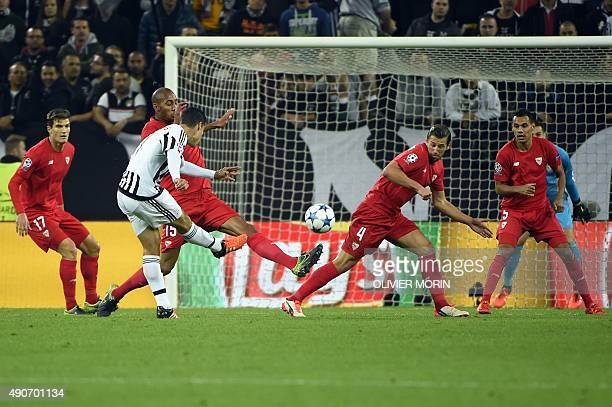 Juventus' midfielder from Brazil Hernanes tries to score during the UEFA Champions League football match Juventus vs FC Sevilla on September 30 at...
