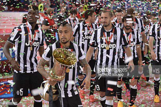 Juventus' midfielder from Chile Arturo Vidal celebrates with the trophy after winning 21 the Italian Tim Cup final match between Juventus and Lazio...