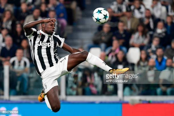 Juventus' midfielder from France Blaise Matuidi jumps to control the ball during the UEFA Champion's League Group D football match Juventus vs...