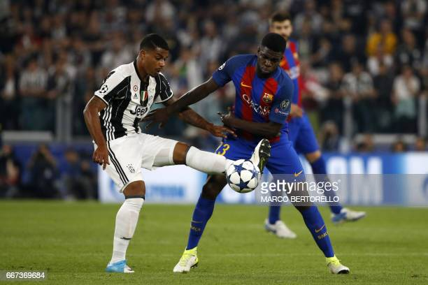 Juventus' midfielder from France Mario Lemina vies with Barcelona's French defender Samuel Umtiti during the UEFA Champions League quarter final...