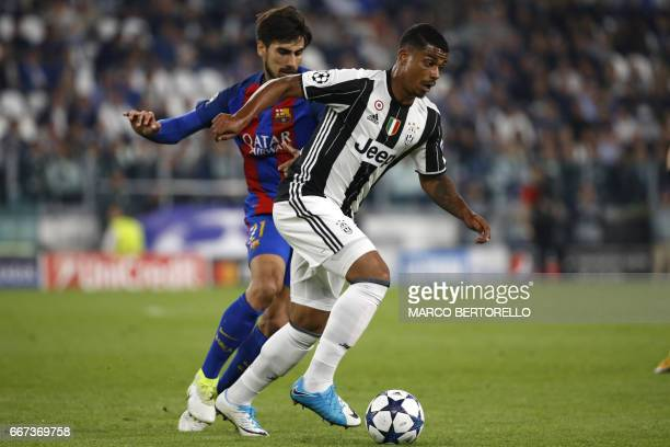 Juventus' midfielder from France Mario Lemina vies with Barcelona's Portuguese midfielder Andre Gomes during the UEFA Champions League quarter final...