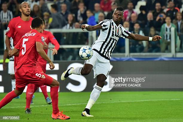 Juventus' midfielder from France Paul Pogba controls the ball in front of Sevilla's French defender Thimothee Kolodziejczak during the UEFA Champions...